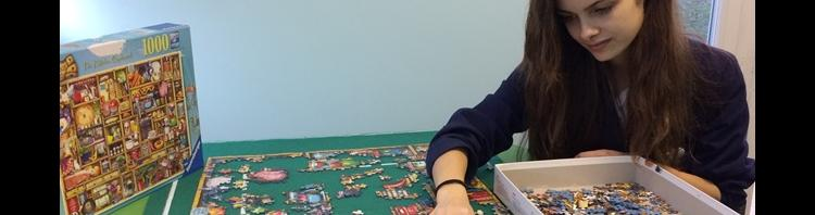 Pupil Ellie enjoys some quiet time in the school's wellbeing room